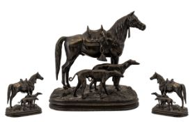 Contemporary Nice Quality Bronze Sculpture of a Riderless Stallion/Horse with Two Dogs, on a grass