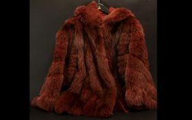 Ladies Fox Fur Coat with hood. Two slit side pockets, cord front fastenings. Approx size 14/16.