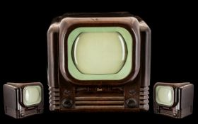 Vintage Bush May 1950s Television housed in a brown Bakelite case in the Deco style. The 9 inch TV-