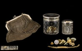 A Silver Hallmarked Framed Mesh Purse with chain handle, of typical form. The purse is leather lined
