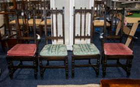 Set of Four Jacobean Ercol Style Chairs - carved arch back rail turned and carved supports,