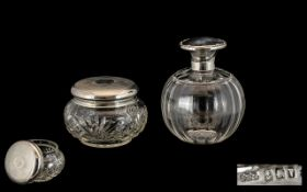 A Globular Shaped Glass Perfume Bottle with Sterling Silver Collar and Hinged Top with Inner Stopper