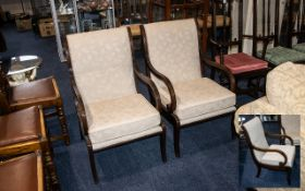 A Pair of Lounge Chairs dark wood frame with beige upholstery, removable cushioned seat and scroll