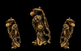 Netsuke. Late 18th century Japanese stags horn netsuke carving depicting a diety of fine