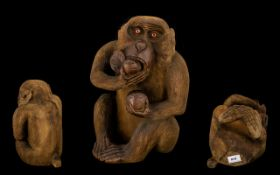 Japanese Large and Impressive Meiji Period Finely Carved Boxwood Seated Monkey Figure eating a peach