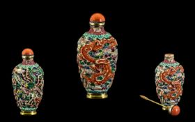 A Qianlong period Snuff Bottle. A Qianlong period moulded and carved snuff bottle with a Dragon