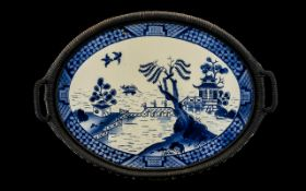 An Early 20thC Twin Handled Tray with a blue and white ceramic plaque, blue and white pagoda pattern