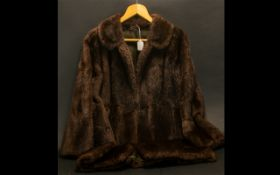 Ladies Musquash Fur Coat. 3/4 Length coat in rich brown colour, with full length sleeves, revere