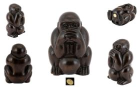 Japanese - Carved Boxwood Netsuke Depicts a Seated Monkey with Hands Covering Mouth, Ball Between
