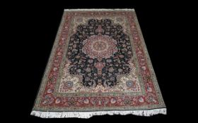 A Persian Isfahan Carpet of Extremely fine quality, close knotted weave, the central panel and