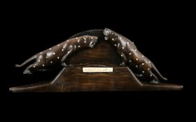 A 1920's Carved Figure of Two Leopards from Malawi.