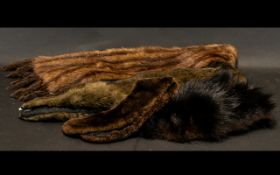 Collection of Fur Items to include a fur stole in mink with tail fringing; a small dark brown fur