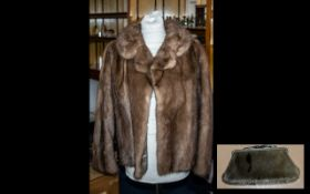 Mink Jacket in pale brown colour, with collar and reveres, hook and eye fastening, 3/4 sleeves and