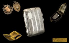 Collection of silver. Cigarette case Birmingham 1926, silver hall marked running medal and shield