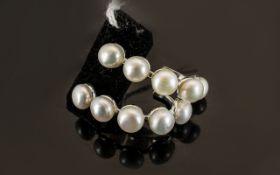 White Fresh Water Pearl J-Hoop Earrings, each earring having five natural white, fresh water