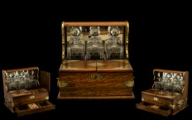 Golden Oak Tantalus & Games Compendium Containing Three Decanters, The Front With Hinged Top, Push