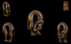 A Japanese Boxwood Netsuke - In The Form Of A Monkey Eating Fruit. Signed To Back Of Leg. Height