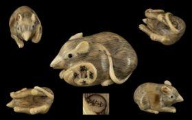 19th Century Japanese Okimono Rat. Ivory Okimono fine quality depicting a rat carrying a disc shaped