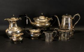 A Silver Plated Four Piece Tea and Coffee Set of plain form with reeded edge. Marked Harts EPNS.