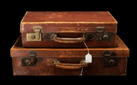 Early 20th Century Leather Suitcases. 2 leather suitcases with brass locks, 24 by 13 inches & 20