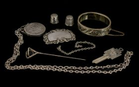 Collection Of Silver Items. Silver Crown 1892 on chain, Silver hall marked spirit label, Silver hall