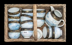 1950s wicker basket with a quantity of Japanese Porcelain comprising cups & teapot, with blue and