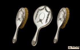 Ladies Sterling Silver 3 Piece Vanity Set comprising Hand Mirror and Two Brushes. All pieces in