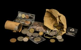 A Small Mixed Lot of Low Value Coins to include a collection of half pennies. To include a roll of
