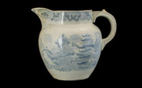 19thC Large Blue and White Printed Staffordshire Milk Jug in the willow pattern. 9.5 inches in