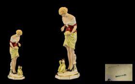 Czechoslovakia Fine Quality Hand Painted 1930's Porcelain Figure of a young woman 'Feeding the