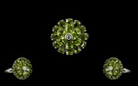 Peridot Circular Floral Style Ring, two