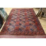 Lot 897 - A Caucasian red ground rug