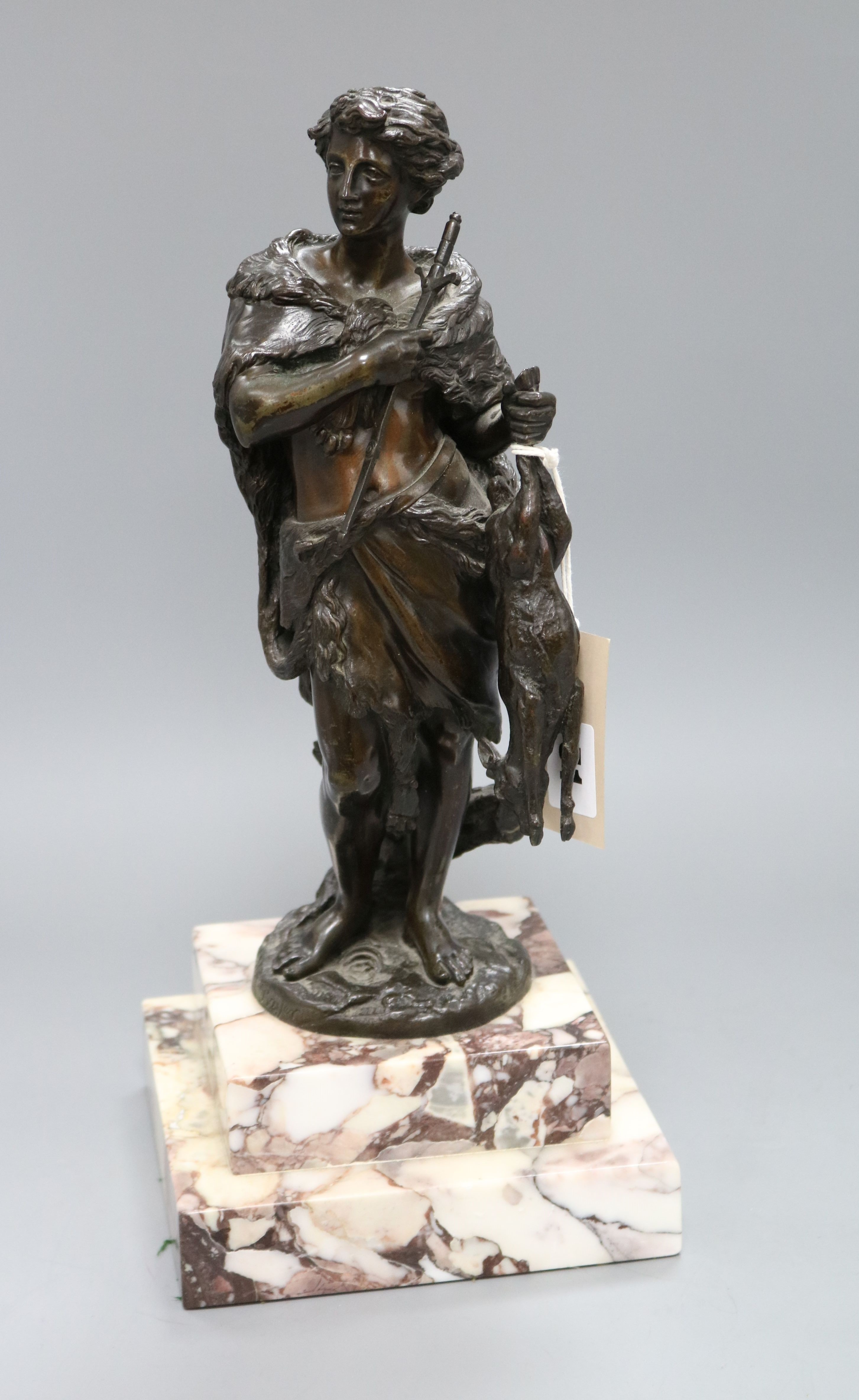 Lot 51 - Bayer, A figural 19th century bronze of a huntsman holding a hare, signed, height 38cm