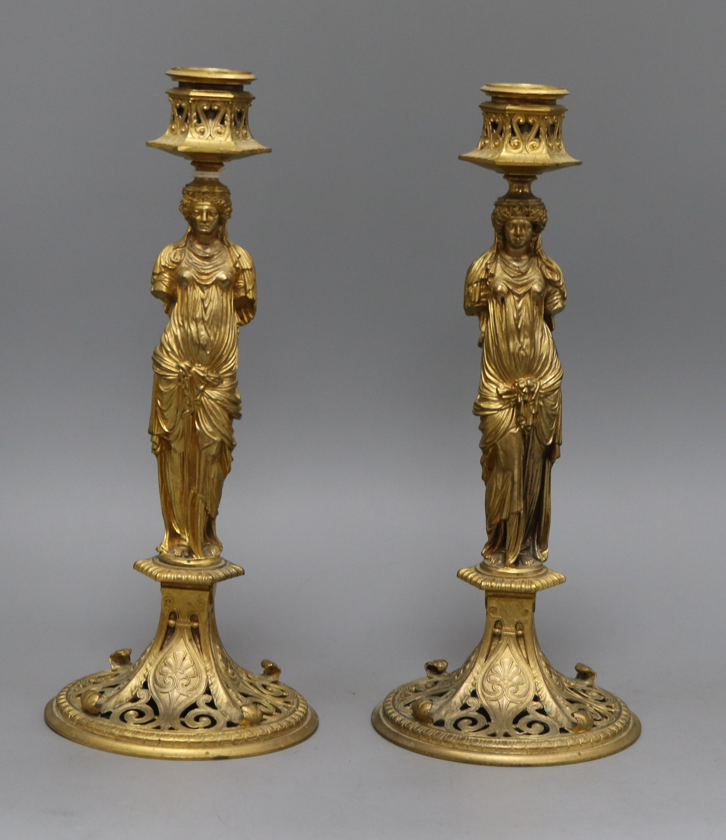 Lot 29 - A pair of Grecian revival ormolu candlesticks height 27cm