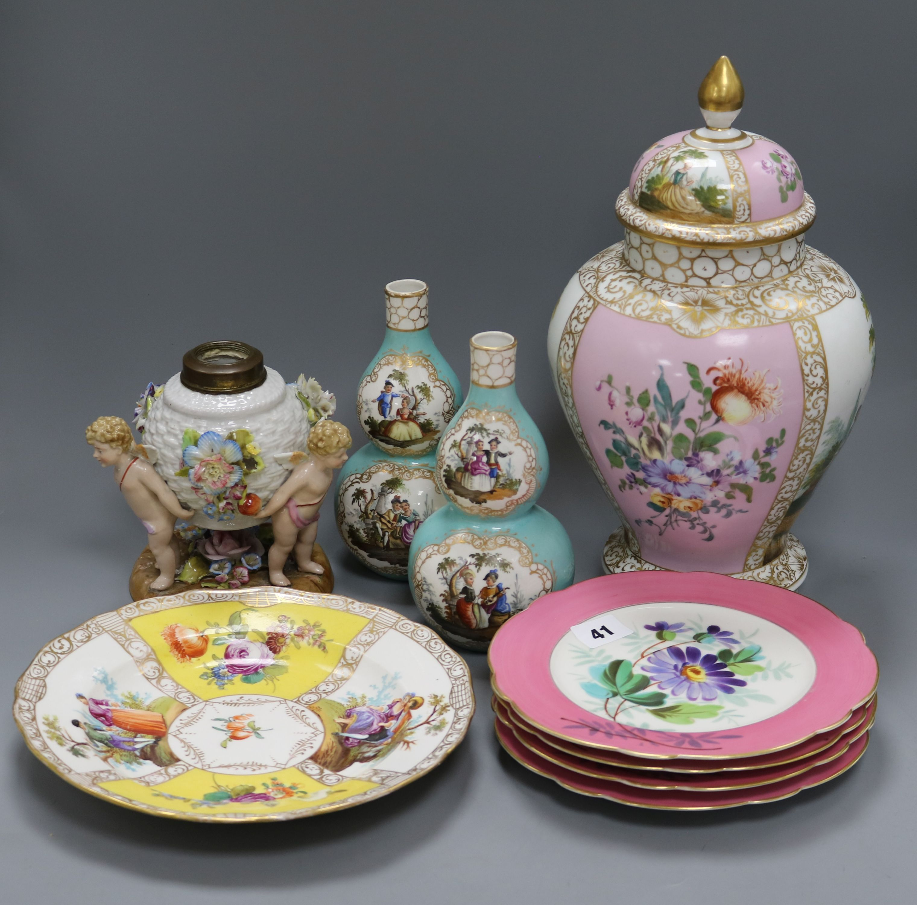 Lot 41 - A Crown Dresden jar and cover, a pair of double gourd vases, a figural oil lamp, a Dresden plate and