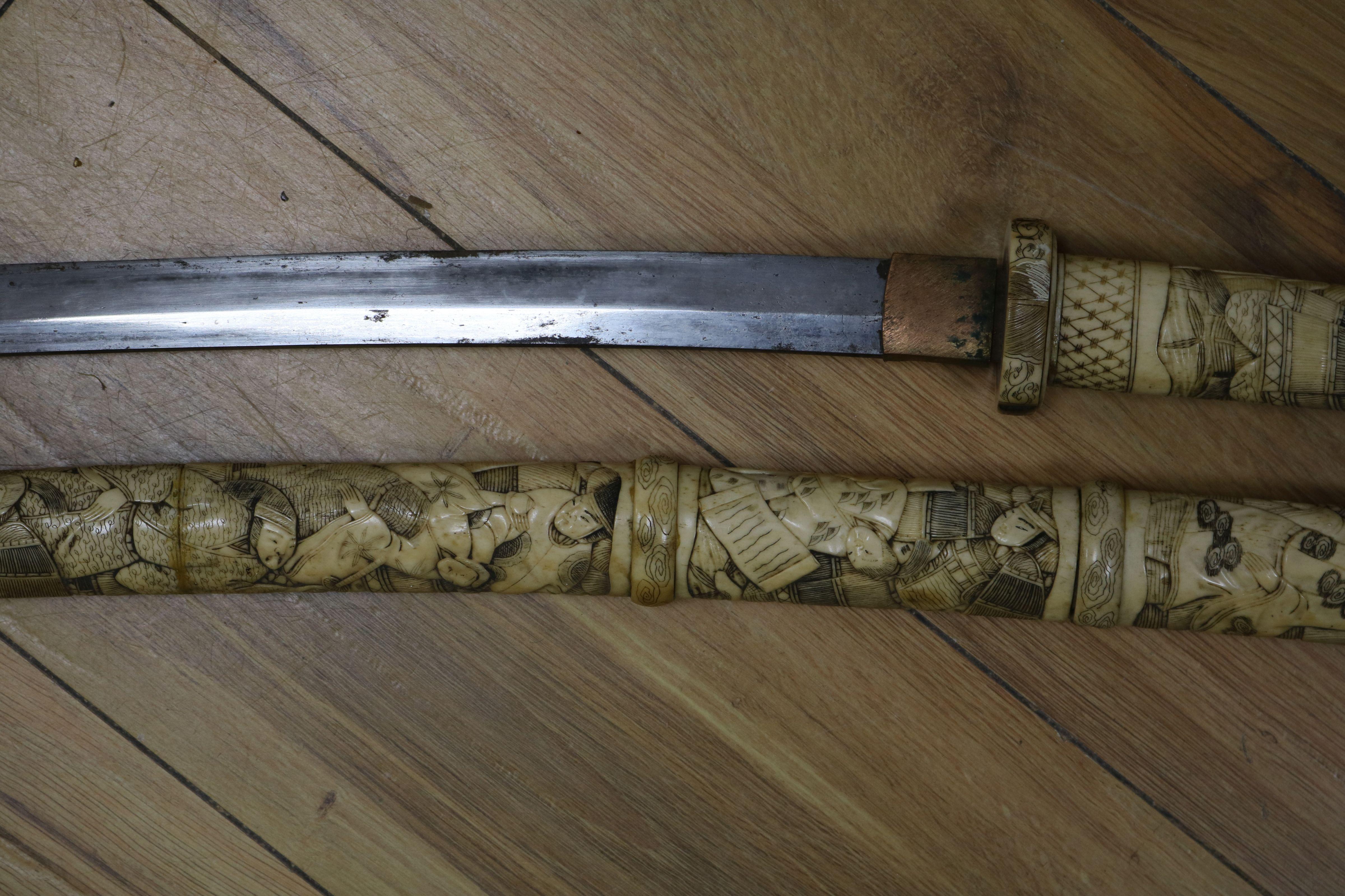 Lot 54 - A Japanese carved bone katana short sword length 82cm
