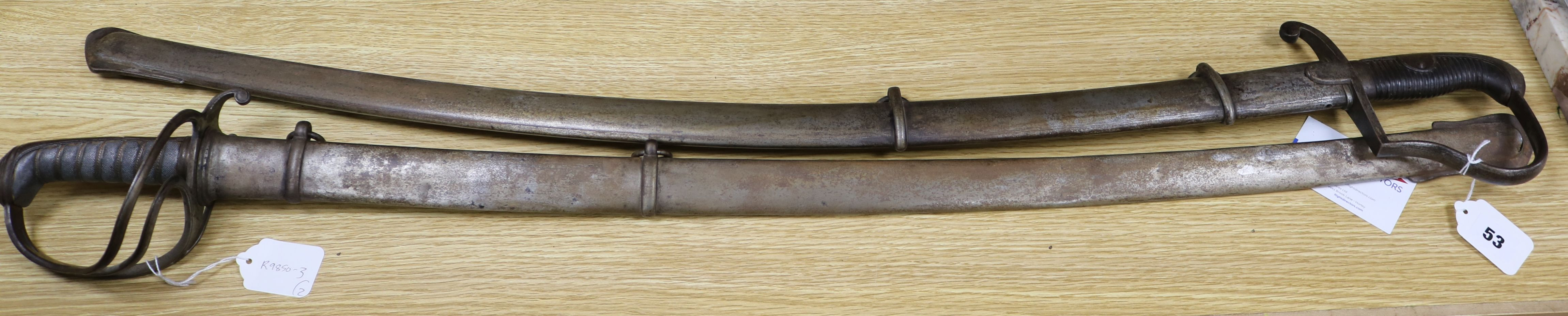 Lot 53 - A Victorian sabre with etched blade and a mid 19th century sabre, both with scabbards