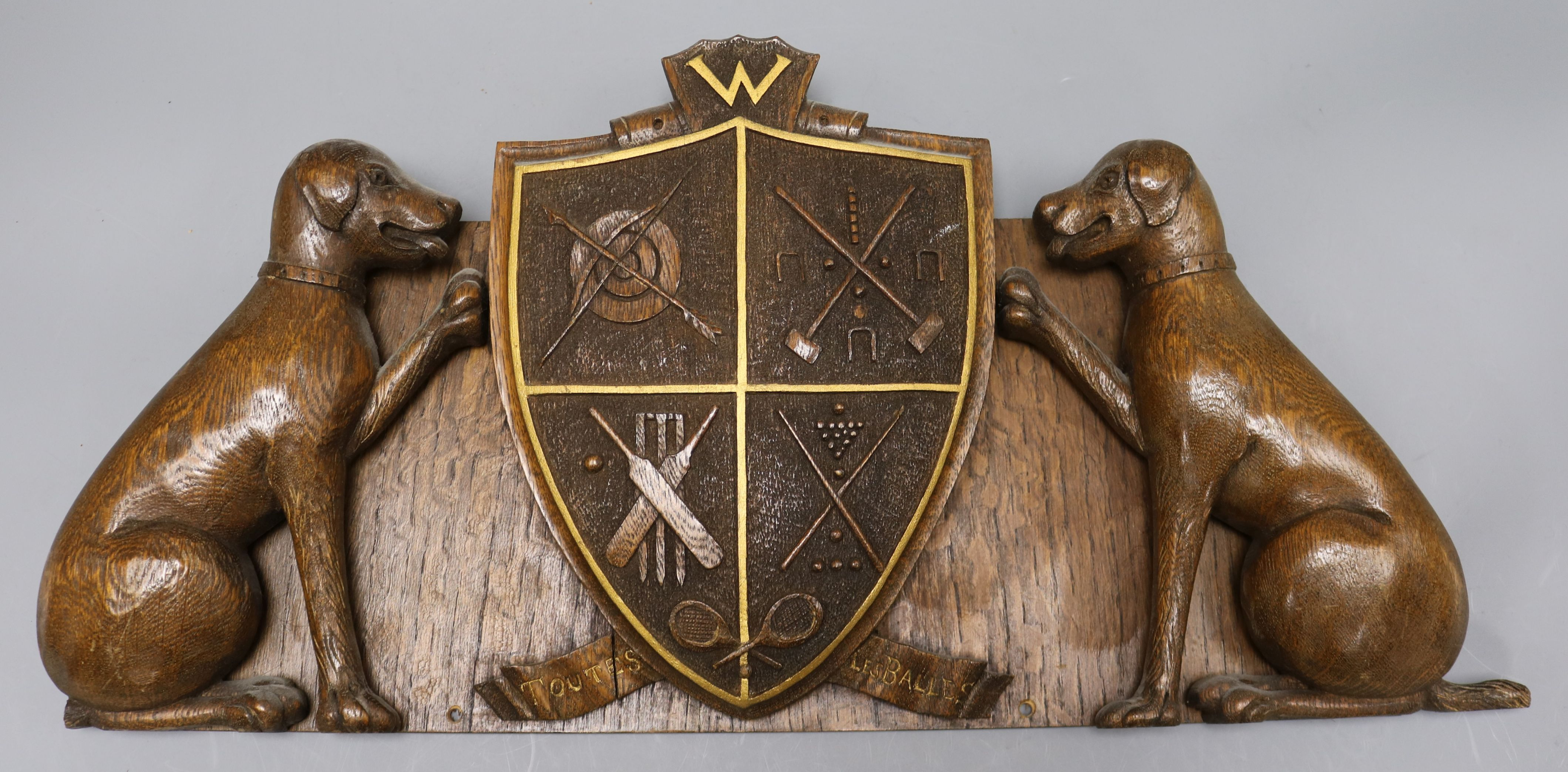 Lot 46 - A carved oak sporting plaque, Withyshaw width 54cm height 26cm