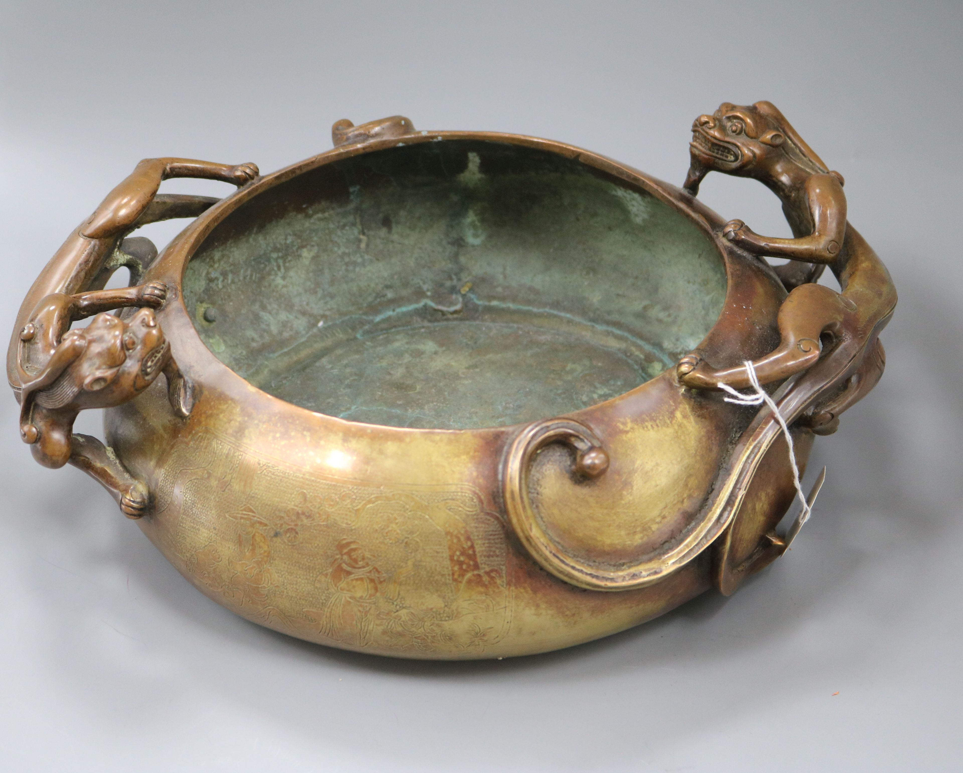 Lot 49 - A large Chinese bronze 'dragon' censer, Xuande mark length 38cm