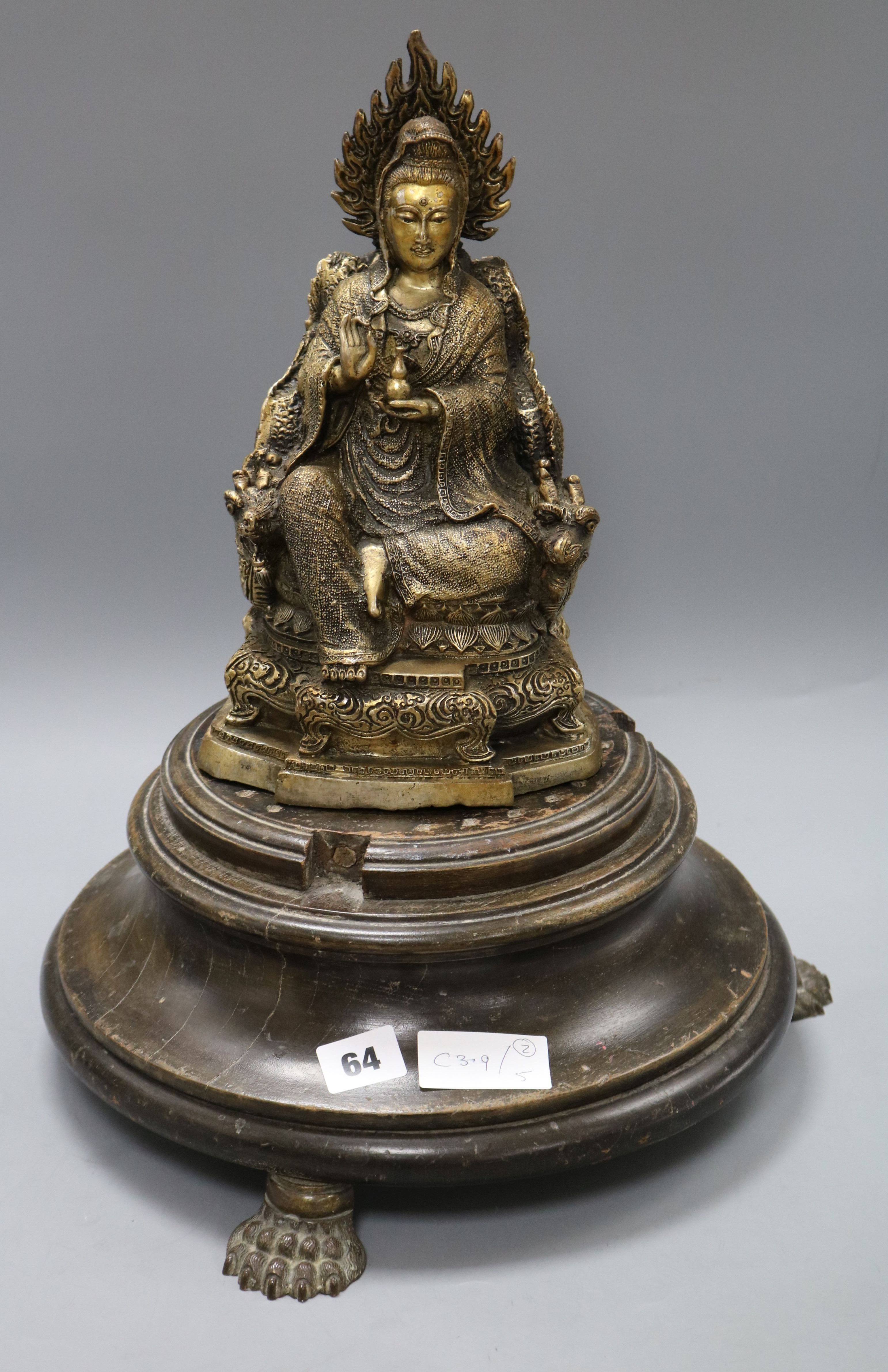 Lot 64 - A Buddha and an associated wooden base on claw feet height excl. stand 28.5cm