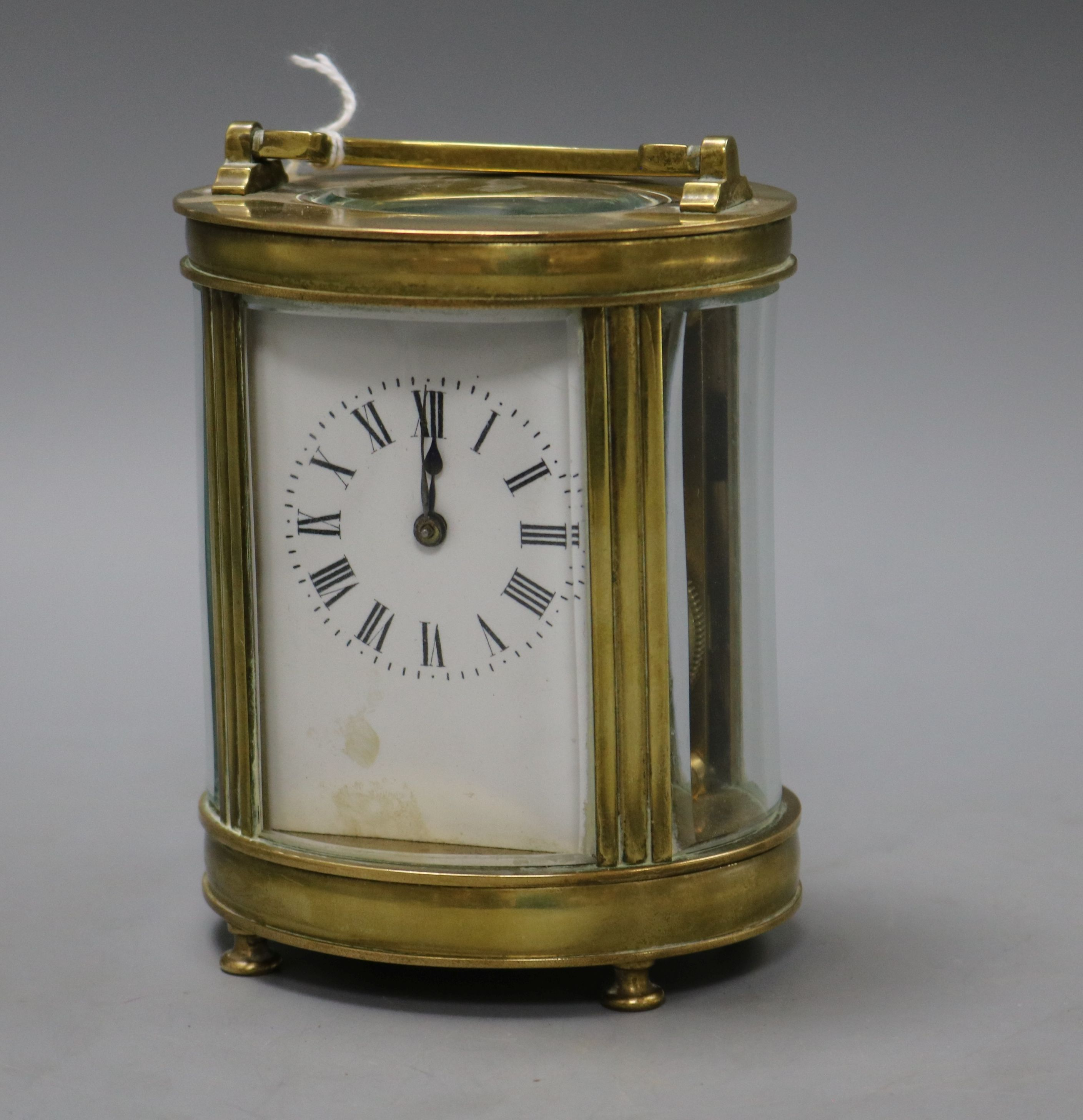 Lot 166 - An oval four glass carriage clock
