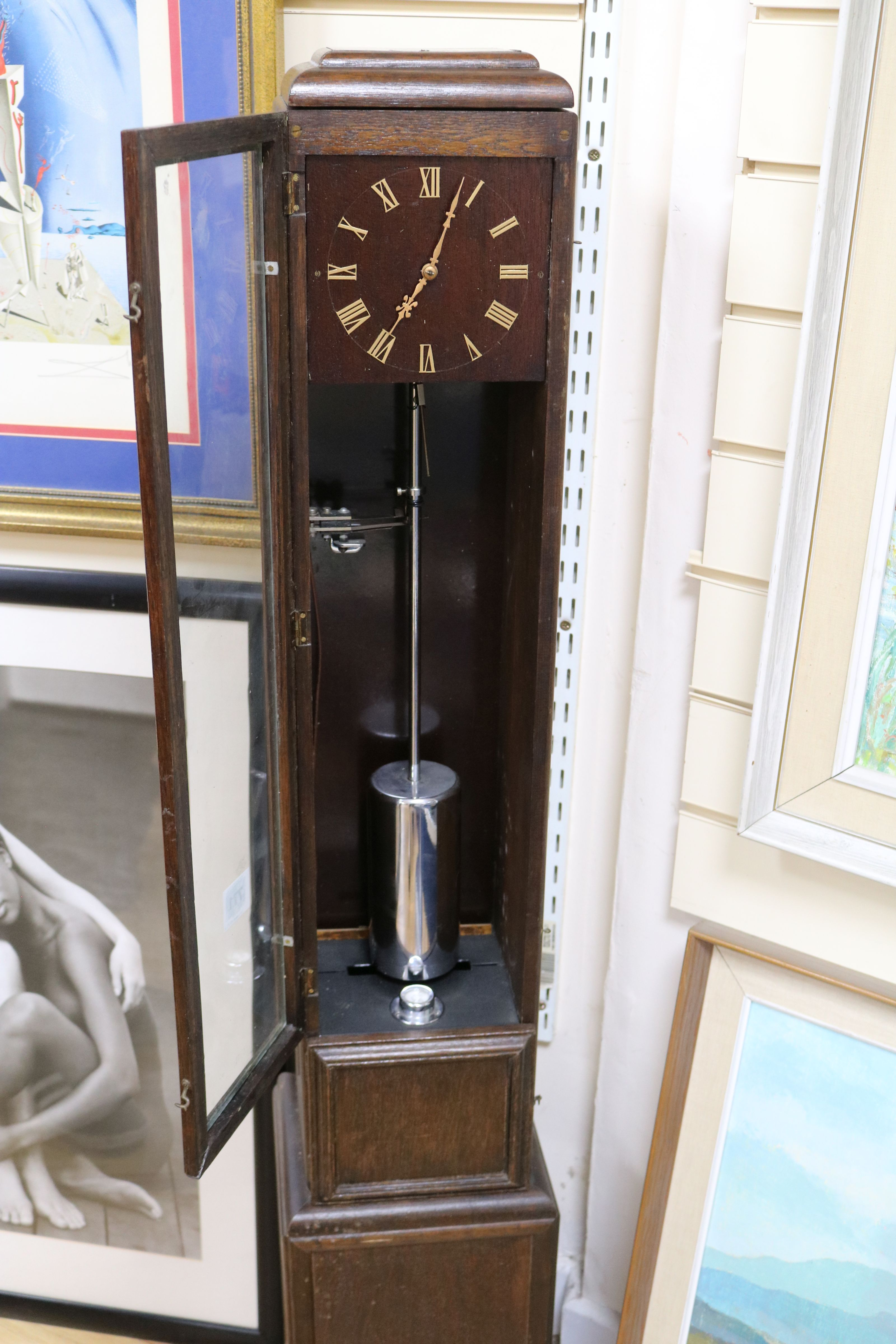 Lot 723 - An oak electric longcase clock H.125cm