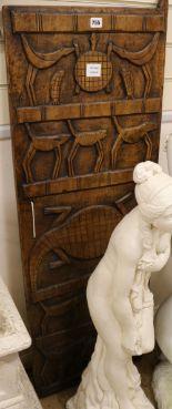 Lot 755 - A West African hardwood grain store door carving W.44cm