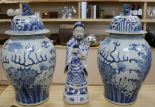 Lot 144 - A pair of modern Chinese blue and white baluster vases and a blue and white figure of a sage holding