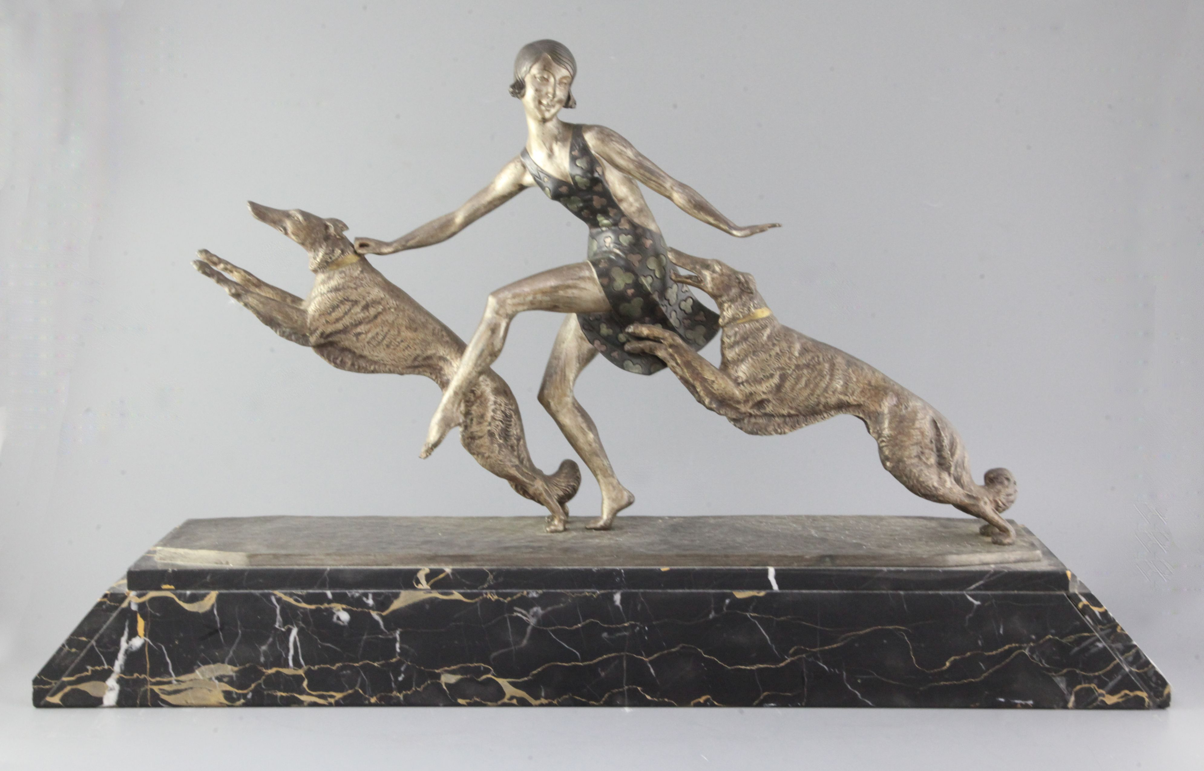 Lot 59 - Jean Lormier (French 19th/20th century). An Art Deco patinated bronze group of a young lady with a