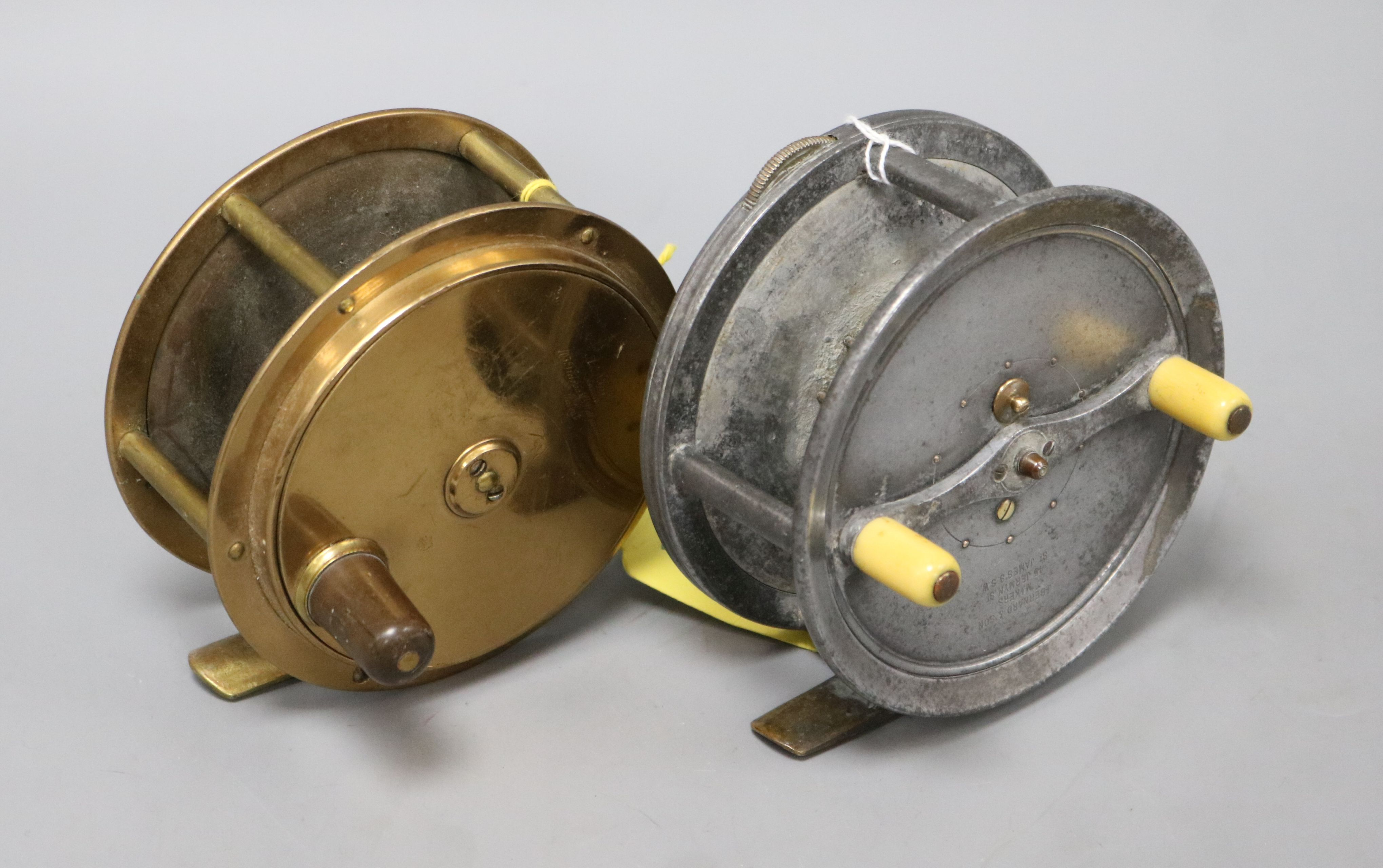 Lot 58 - J. Bernard and Son 4.5 inch fishing reel and an all brass reel by A and N CPL Westminster