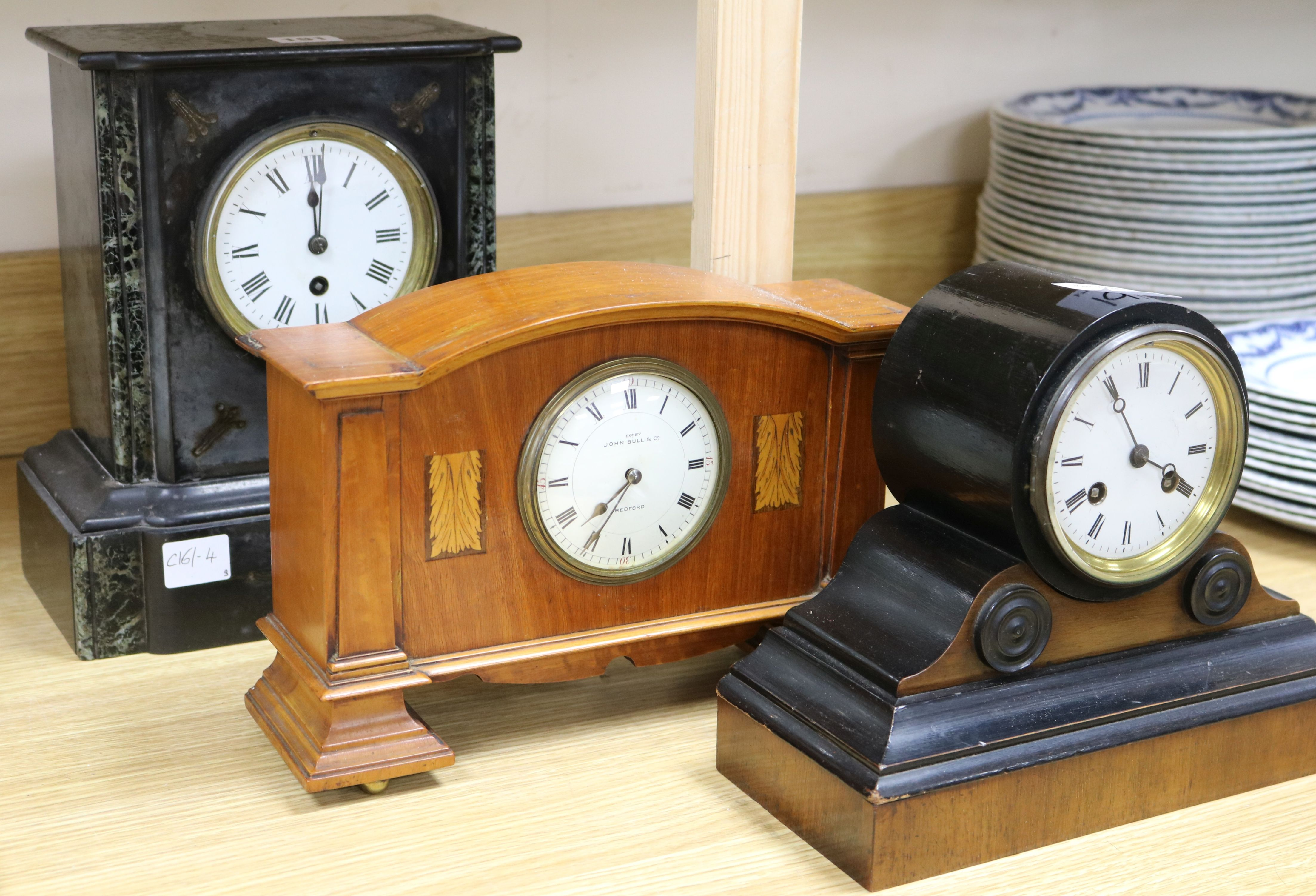 Lot 191 - A John Bull & Co Edwardian mantel clock, a slate mantel clock and another