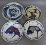 Lot 123 - Three Chinese blue and white fish dishes and a similar dragon dish