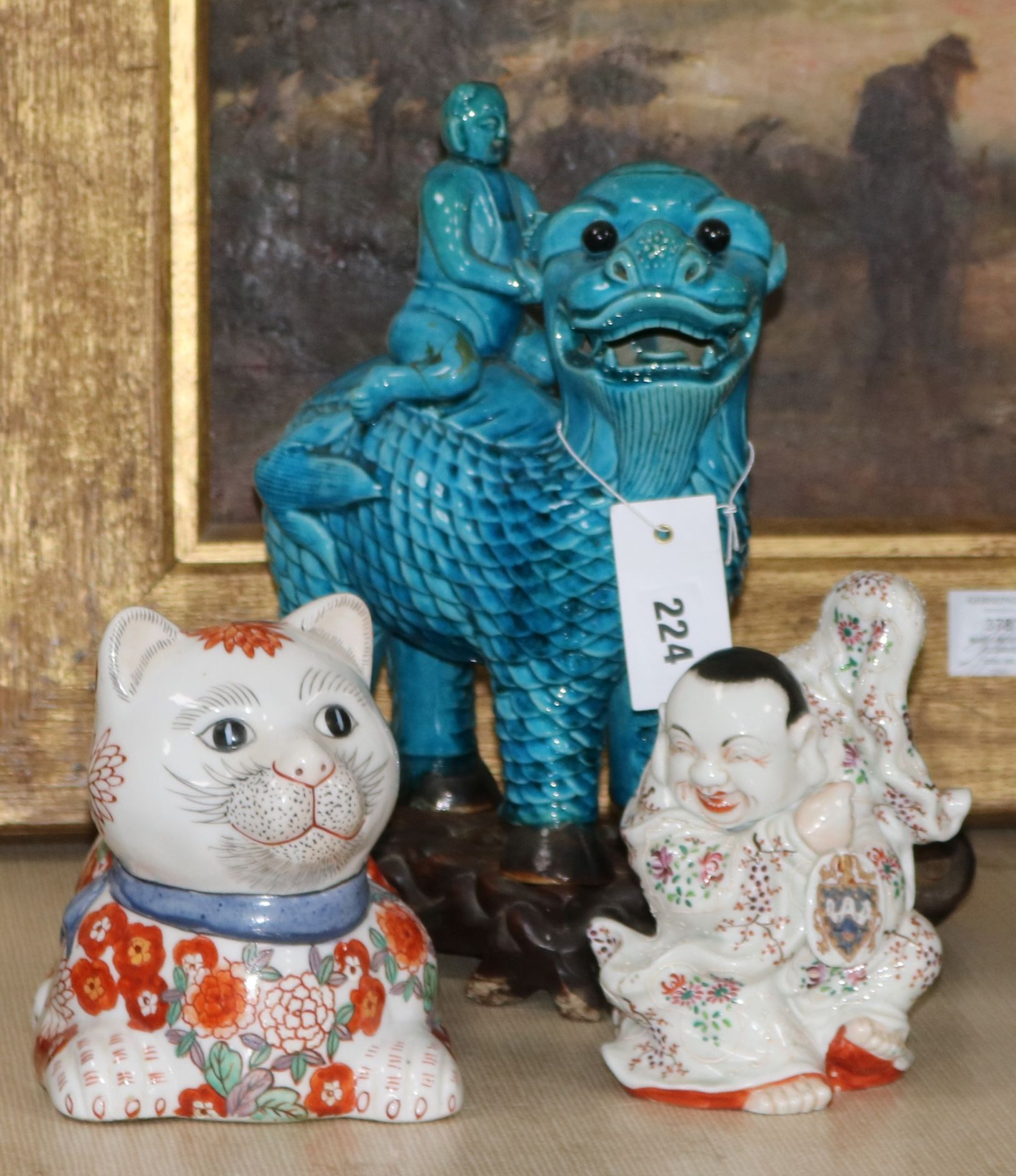 Lot 224 - A stoneware Dog of Fo, a Sampson style Buddha and a decorative cat