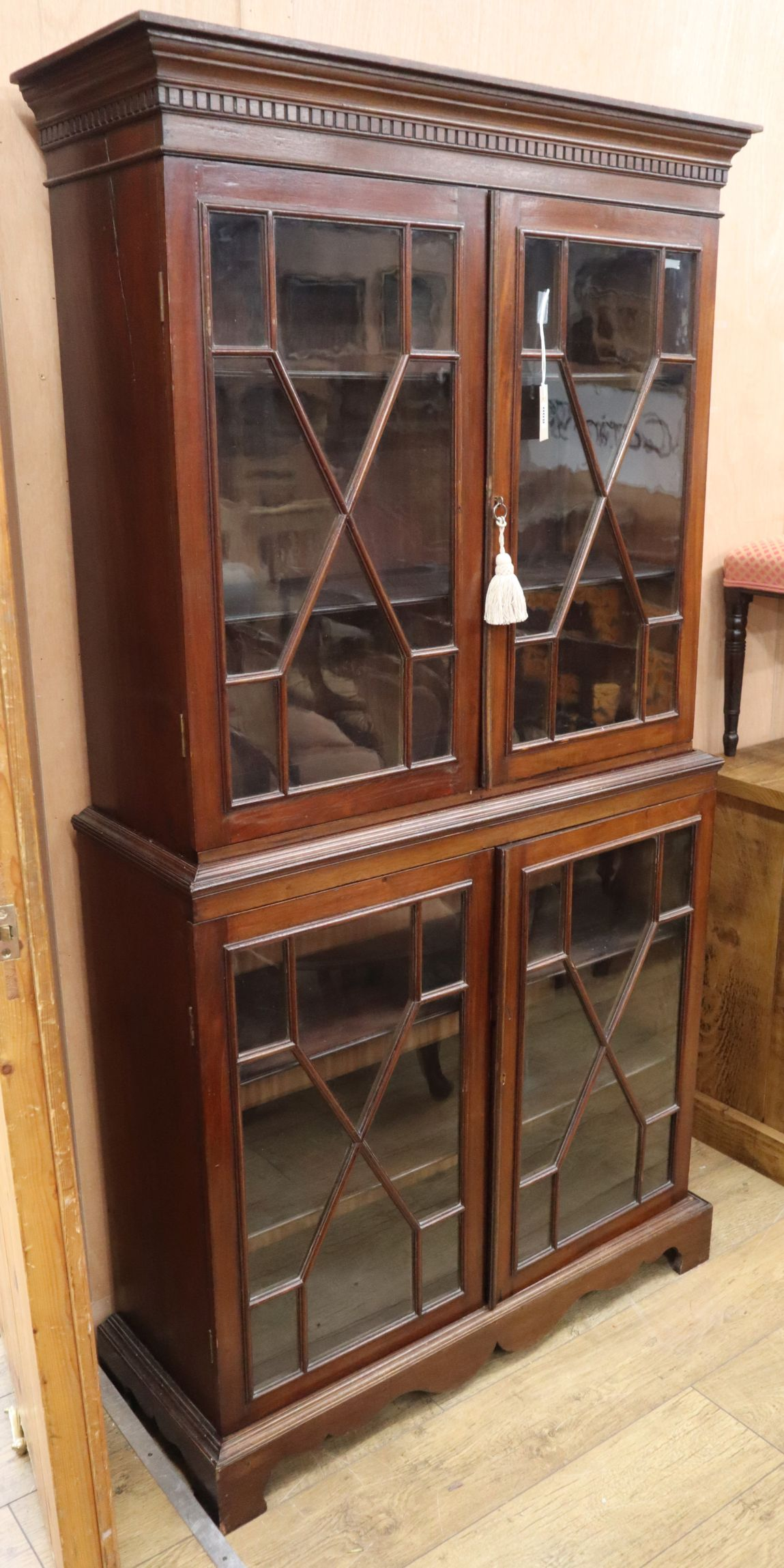 Lot 800 - A Georgian design mahogany two-section glazed bookcase H.186cm